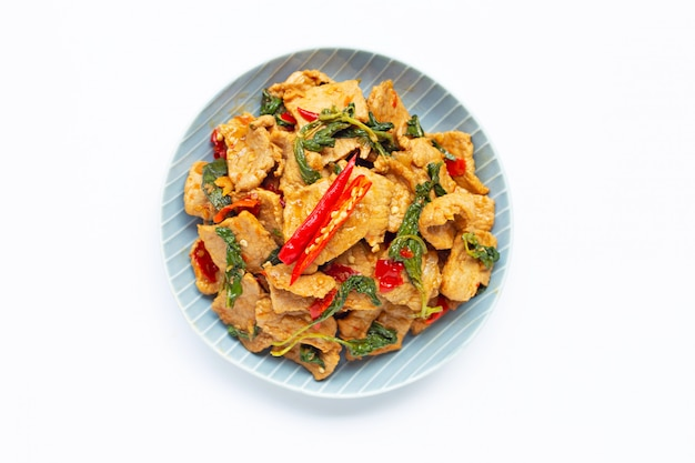 Stir-fried hot and spicy pork with basil on white