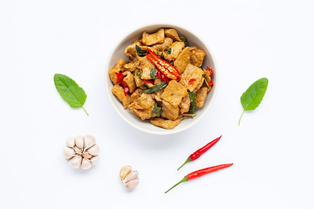 Stir-fried hot and spicy pork with basil on white Photo