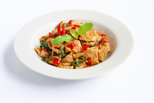 Stir-fried hot and spicy pork with holy basil on white