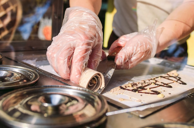 Stir-fried ice cream rolls at freeze pan. organic, natural rolled ice cream, hand made dessert.