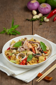 Stir-fried instant noodles with seafood and variety vegetable
