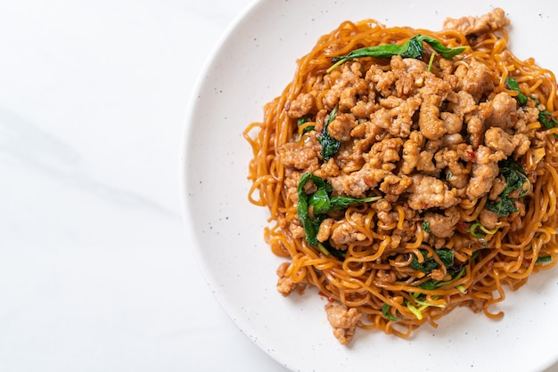 Stir-fried instant noodles with thai basil and minced pork - asian food style
