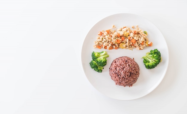 Stir fried minced chicken and carrot with berry rice