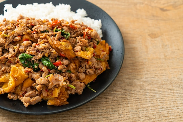 Stir-fried minced pork with basil and egg topped on rice - asian food style