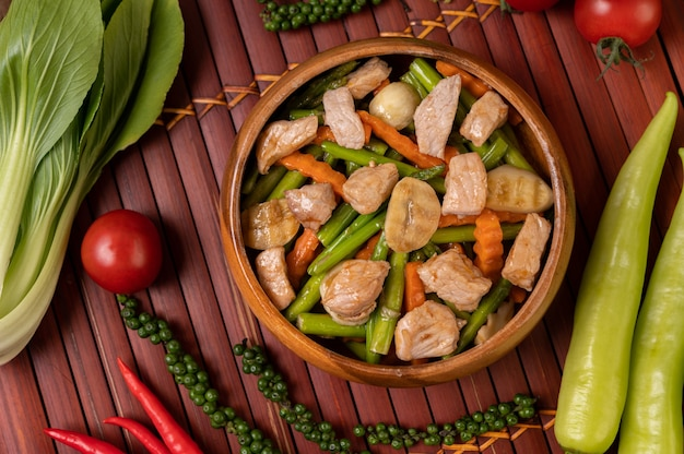 Stir-fried mixed vegetables containing green peas, carrots, mushrooms, corn, broccoli, and pork