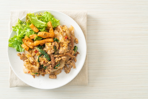 Stir-fried noodle with minced chicken and basil - asian food style