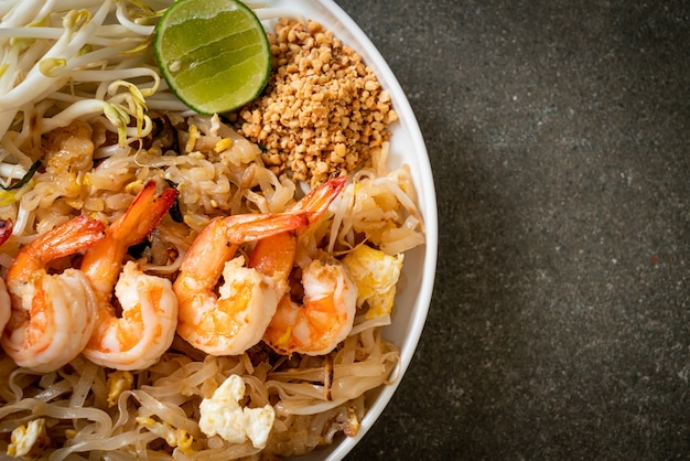Stir-fried noodles with shrimp and sprouts or pad thai - asian food style