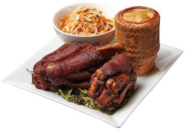 Stir-fried pork leg with papaya salad and sticky rice