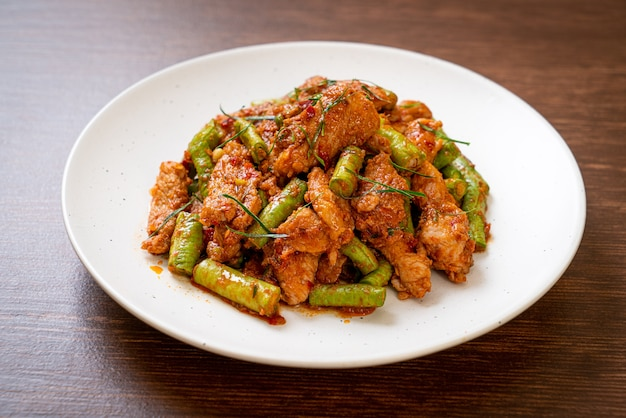 Stir fried pork and red curry paste with sting bean - asian food style