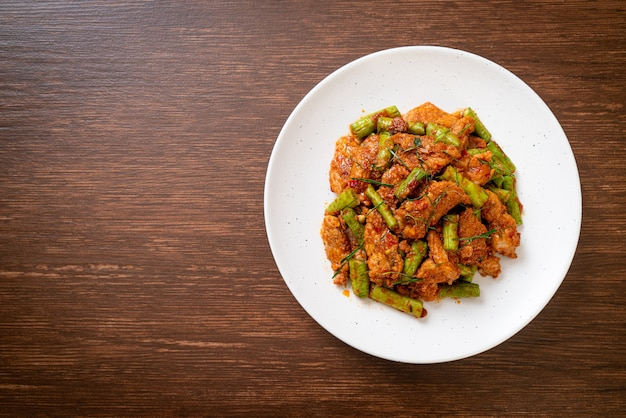 Stir fried pork and red curry paste with sting bean. asian food style