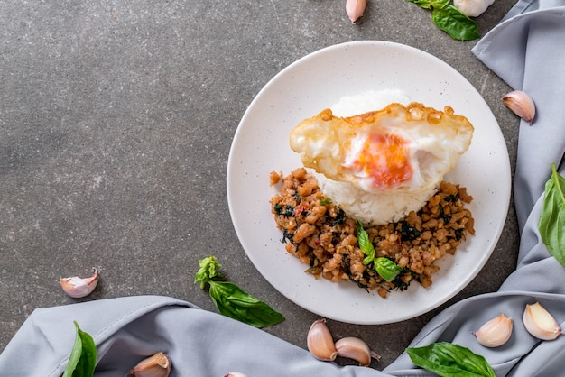 Stir-fried pork with basil  on rice and fried egg