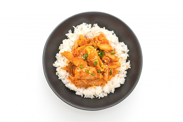 Stir fried pork with kimchi on topped rice isolated on white background