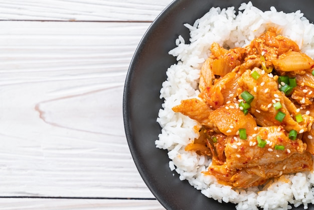 Stir fried pork with kimchi on topped rice