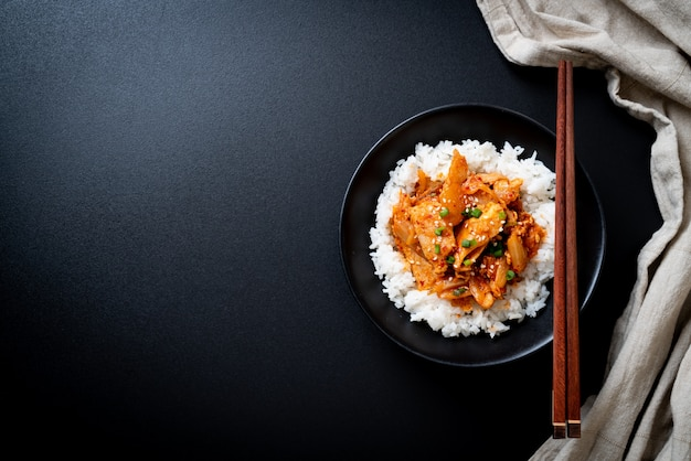Stir fried pork with kimchi on topped rice