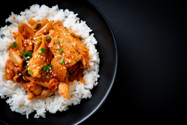 Stir-fried pork with kimchi on topped rice