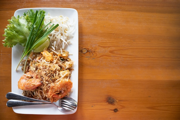 Stir-fried rice noodles with fresh water prawn served with vegetable