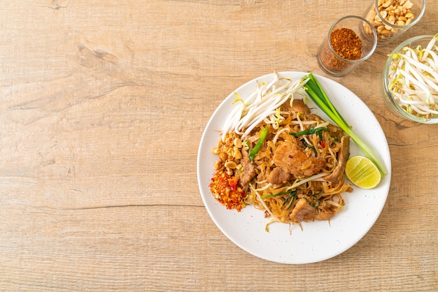 Stir-fried rice noodles with pork in asian style