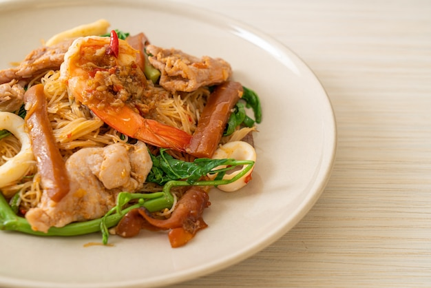 Stir-fried rice vermicelli and water mimosa with mix meat. asian food style