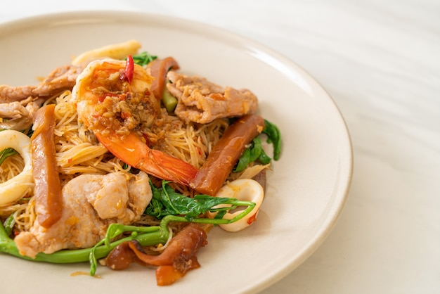 Stir-fried rice vermicelli and water mimosa with mix meat - asian food style