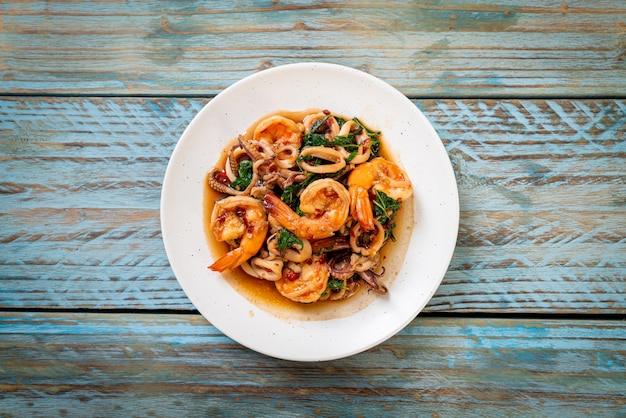 Stir-fried seafood (shrimps and squid) with thai basil - asian food style