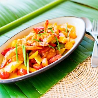 Stir fried shrimp sweet and sour sauce banana leaf