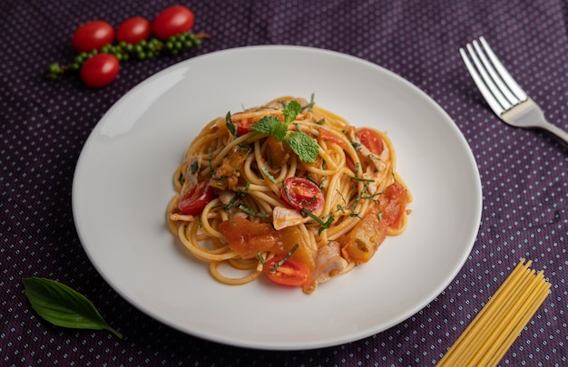 Stir-fried spaghetti beautifully arranged in a white plate.