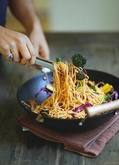 Stir fried spaghetti with organic vegetables