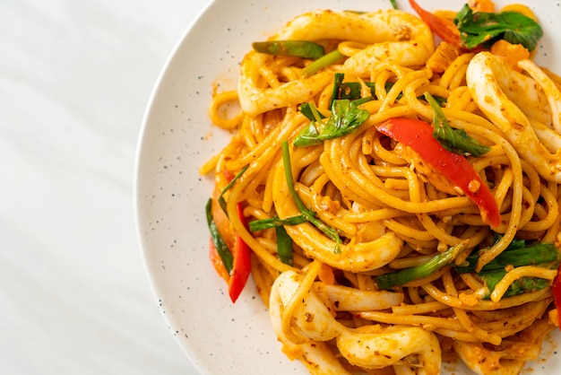 Stir-fried spaghetti with salted egg and squid