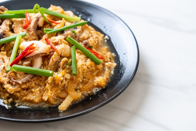 Stir-fried squid or octopus with salted eggs
