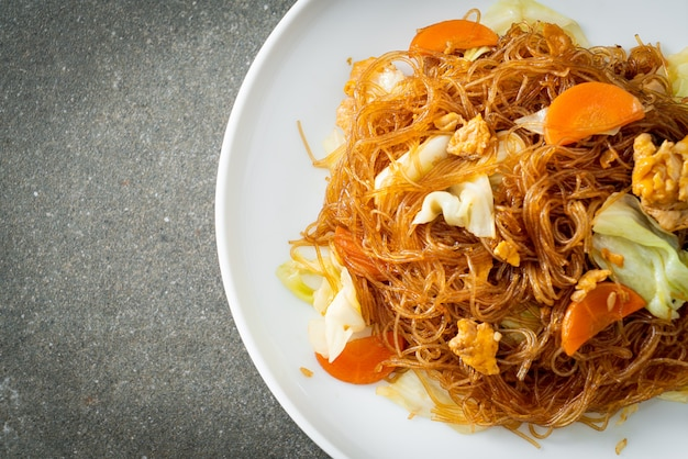 Stir fried vermicelli with cabbage, carrot and egg - vegan food style