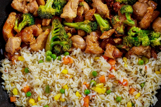 Stir-fry chicken and broccoli with rice. close up..