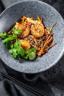 Stir fry rice noodles with shrimps and vegetables asia wok