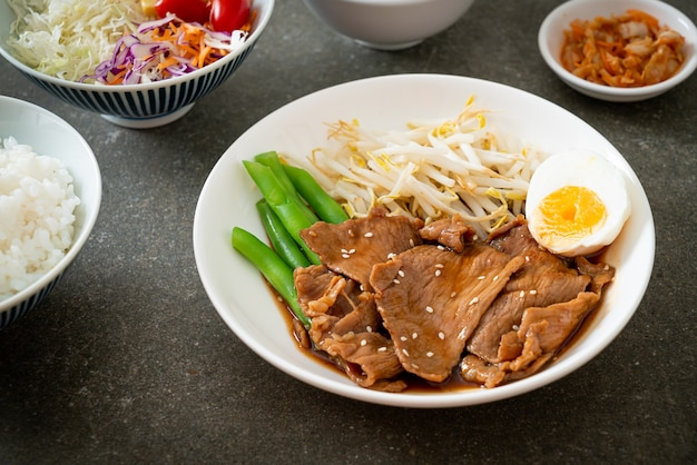 Stir-fry teriyaki pork with sesame seeds ,mung bean sprouts, boiled egg and rice set - japanese food style