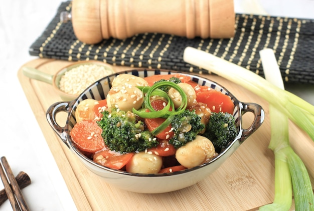 Stir fry vegetable and  quail egg with oyster sauce telur puyuh saus tiram