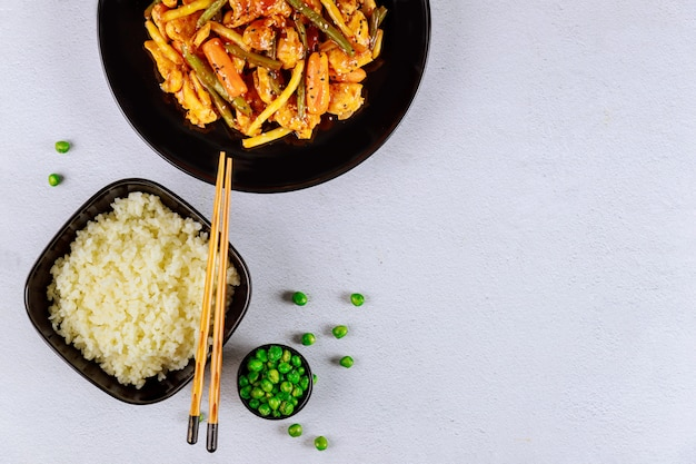 Stir fry vegetables with chicken and rice