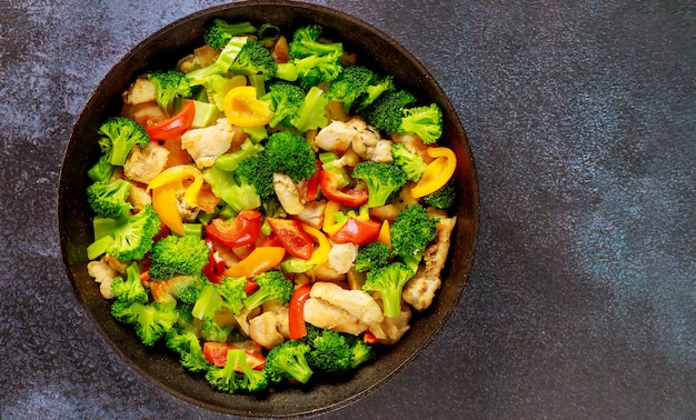 Stir-fry with chicken, broccoli and bell peppers. top view.