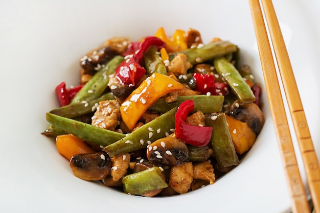 Stir fry with chicken, mushrooms, green beans and sweet peppers