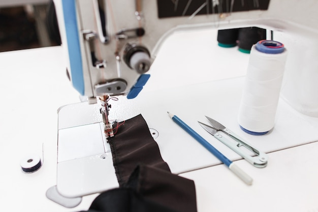 Stitching part of clothes on equipment.