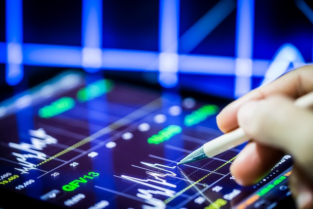 Stock analysis with digital tablet and hand pointing