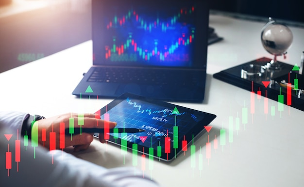 Stock broker looking at graph working and analyzing cryptocurrency