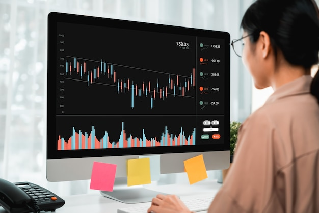 Stock exchange market concept, business people trader looking computer with graphs analysis candle line on table in office, diagrams on screen.
