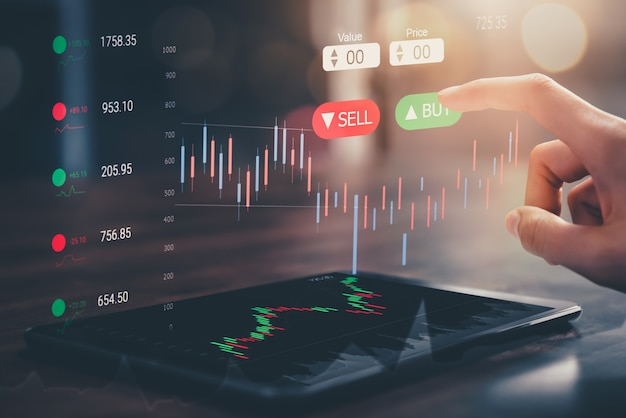 Stock exchange market concept, hand touching on trading icon screen with graphs analysis candle line on bokeh colors light.