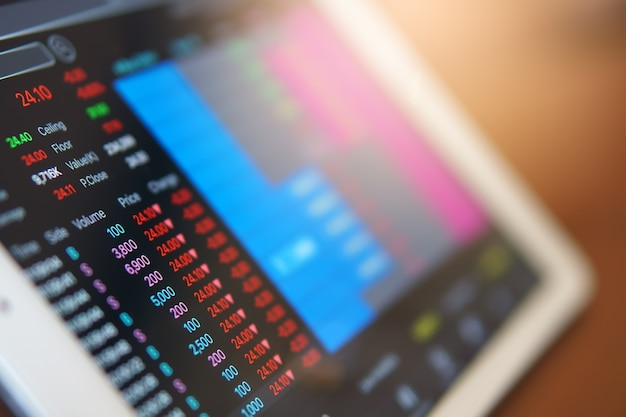Stock market online to fall on tablet screen or laptop for business