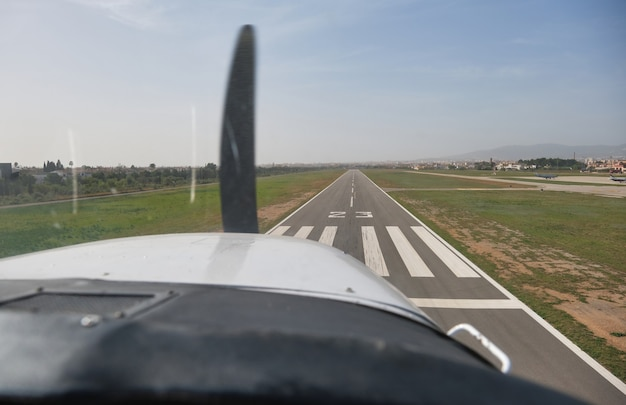 Stock photo of the views from the window of light aircraft while taking off.