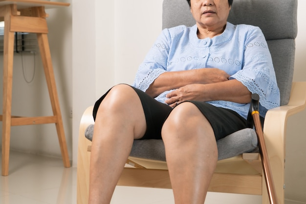 Stomachache of old woman, health problem concept