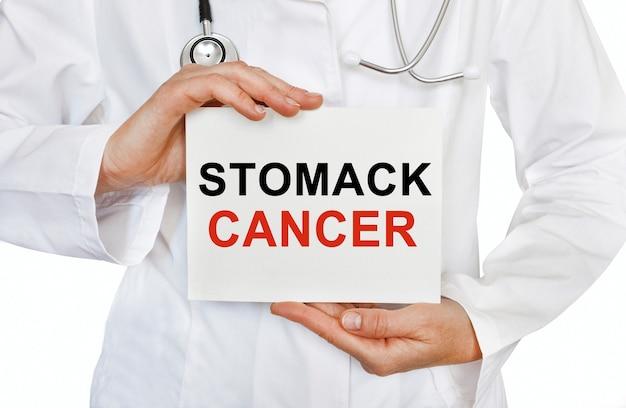 Stomack cancer card in hands of medical doctor