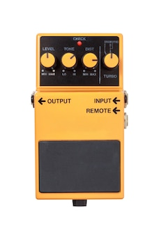 Stomp box electric guitar signal distortion orange effects foot pedal isolated on white
