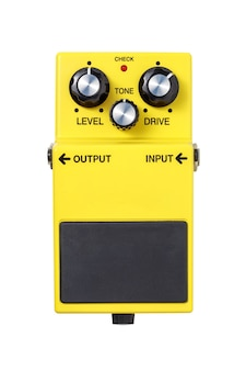 Stomp box electric guitar signal over drive yellow effects foot pedal isolated on white