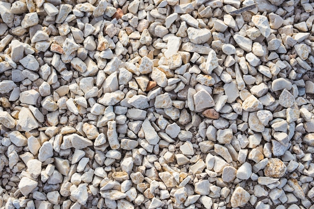 Stone background texture on the beach, top view.