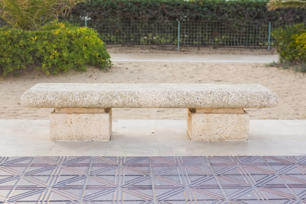 Stone bench in the city park outdoors